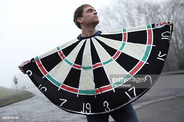A fan poses dressed as a darts board outside Alexandra Palace ahead of the quarter finals of the 2016 William Hill World Darts Championship on...