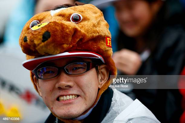 A fan poses during previews to the Formula One Grand Prix of Japan at Suzuka Circuit on September 24 2015 in Suzuka