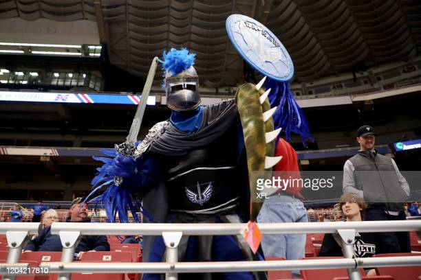 A fan poses for a photo before the XFL game between the Seattle Dragons and the St Louis BattleHawks at The Dome at America's Center on February 29...