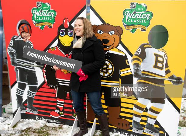 A fan poses for a photo during the Bridgestone NHL Winter Classic Park fan festival at Millenium Park on December 29 2018 in Chicago Illinois