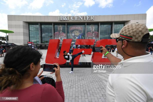 Fan poses for a photo in front of the UFC letters prior to the UFC Fight Night event at BB&T Center on April 27, 2019 in Sunrise, Florida.