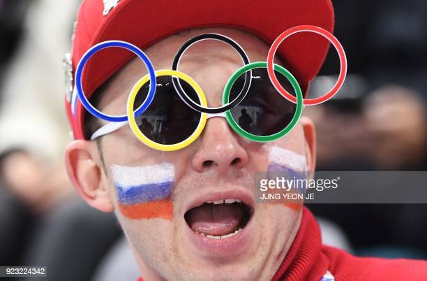 TOPSHOT A fan poses for a photo in the men's semifinal ice hockey match between the Czech Republic and Olympic Athletes from Russia during the...
