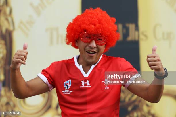 A fan poses for a photo outside the stadium prior to the Rugby World Cup 2019 Group D game between Wales and Georgia at City of Toyota Stadium on...
