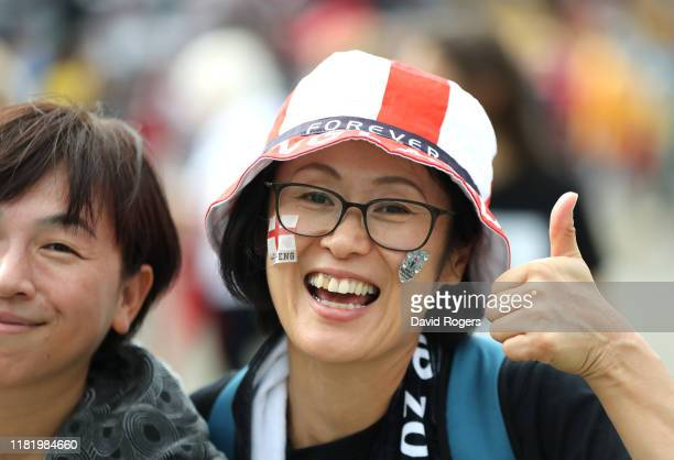 A fan poses for a photo outside the stadium prior to the Rugby World Cup 2019 Quarter Final match between England and Australia at Oita Stadium on...