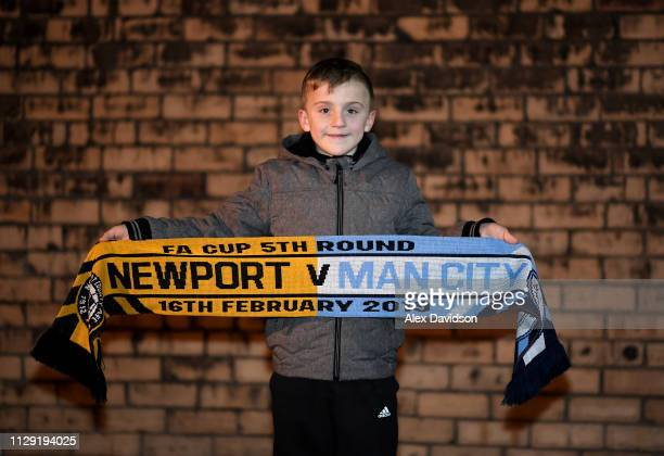 A fan poses for a photo with a Newport County v Manchester City scarf ahead of their FA Cup game on Saturday prior to the Sky Bet League Two match...