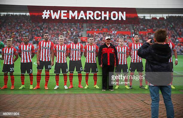 A fan poses for a photograph prior to the Barclays Premier League match between Southampton and Arsenal at St Mary's Stadium on January 1 2015 in...
