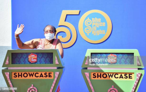 """Fan poses for portrait at CBS """"The Price Is Right"""" 50th Season Celebration at Randy's Donuts on September 30, 2021 in Inglewood, California."""