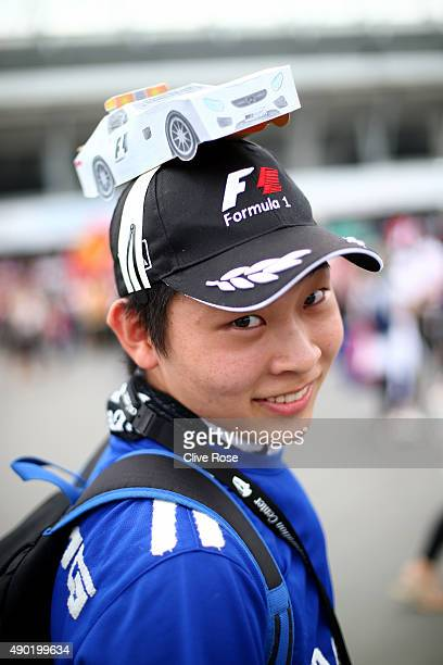 A fan poses outside the circuit before the Formula One Grand Prix of Japan at Suzuka Circuit on September 27 2015 in Suzuka Japan