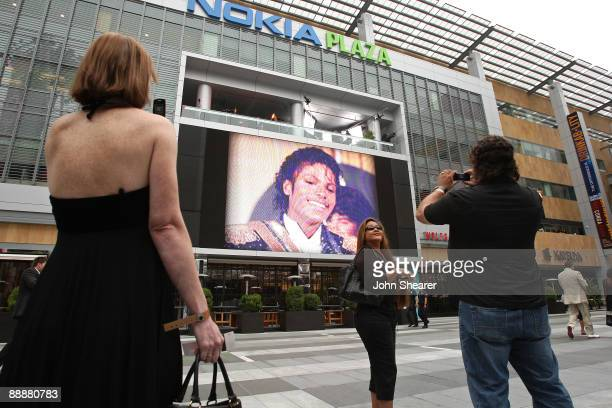Fan poses outside the Michael Jackson public memorial service held at Staples Center on July 7, 2009 in Los Angeles, California. Jackson the iconic...