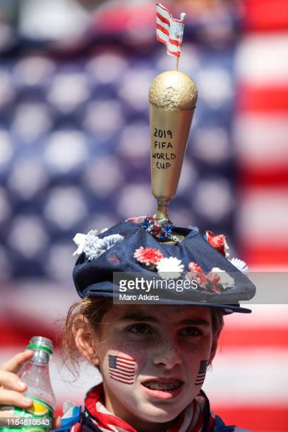 USA fan poses wearing a beret featuring a mock up World Cup trophy during the 2019 FIFA Women's World Cup France Final match between The United...