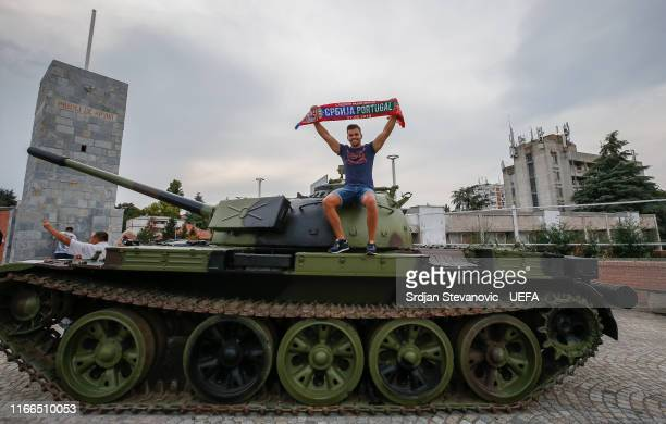 Fan poses with a former Yugoslav army T-55 battle tank seen in front of northern grandstand of Rajko Mitic stadium prior to the UEFA Euro 2020...