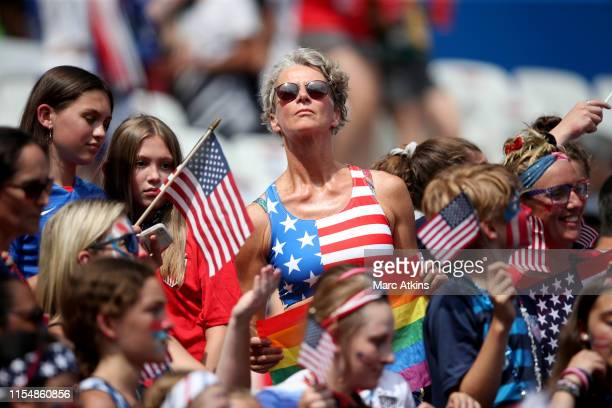 USA fan poses with a gay pride flag during the 2019 FIFA Women's World Cup France Final match between The United States of America and The...