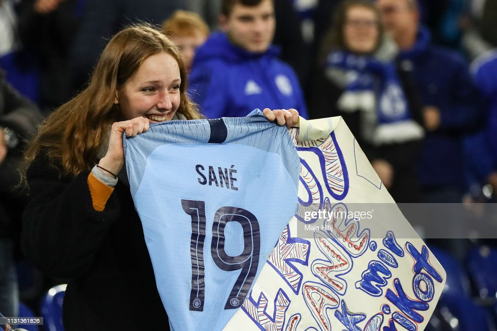 promo code 4bd2c ae095 Fan poses with a jersey she received from Leroy Sane of ...