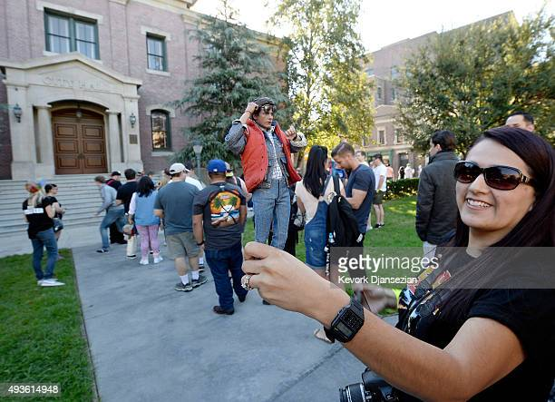 A fan poses with a Marty McFly figuerin in the Hill Valley Courthouse square in the back lot of Universal Studios during Back To The Future day...