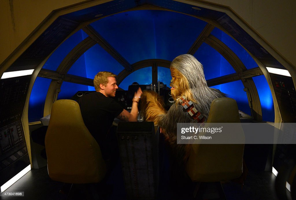 A fan poses with a wax figure of Star Wars character Chewbacca at 'Star Wars At Madame Tussauds' on May 12, 2015 in London, England.