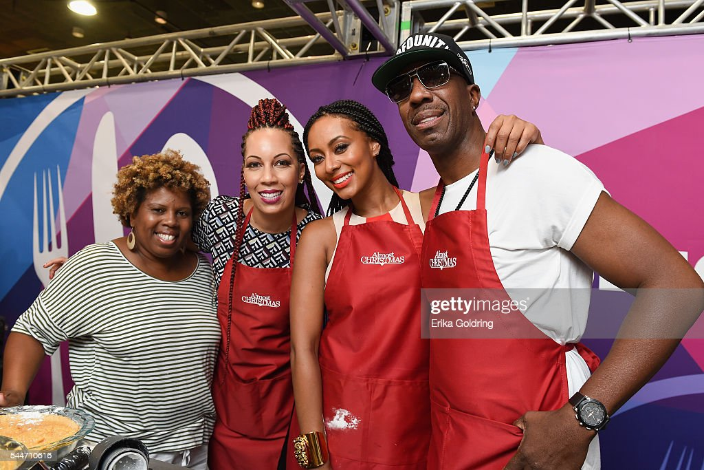 A fan poses with Almost Christmas producer Lyn Talbert, actress Keri ...