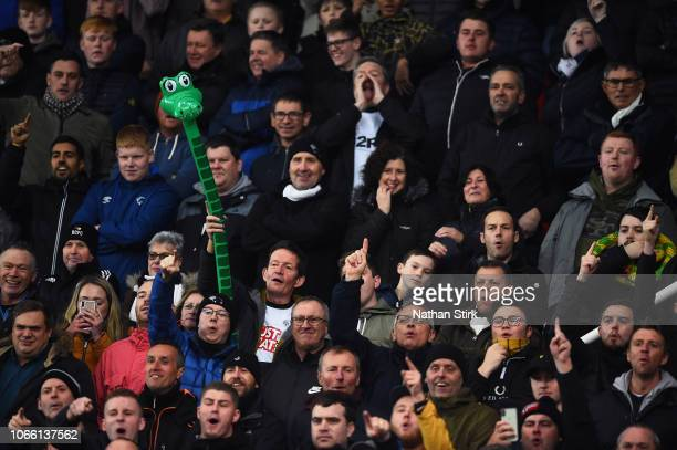 A fan poses with an inflatable snake during the Sky Bet Championship match between Stoke City and Derby County at Bet365 Stadium on November 28 2018...
