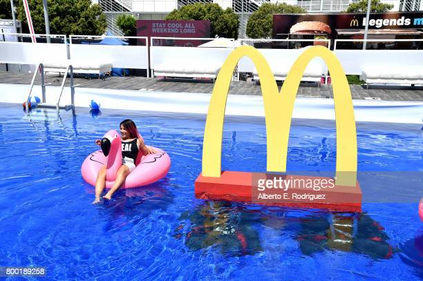 Fan poses with McDonald's branding at day one of the Pool Groove, sponsored by McDonald's, during the 2017 BET Experience at Gilbert Lindsey Plaza on...