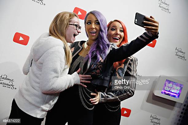 A fan poses with YouTube sensation Jenna Marbles and a Madame Tussauds figure of Jenna Marbles during the unveiling at Madame Tussauds New York on...