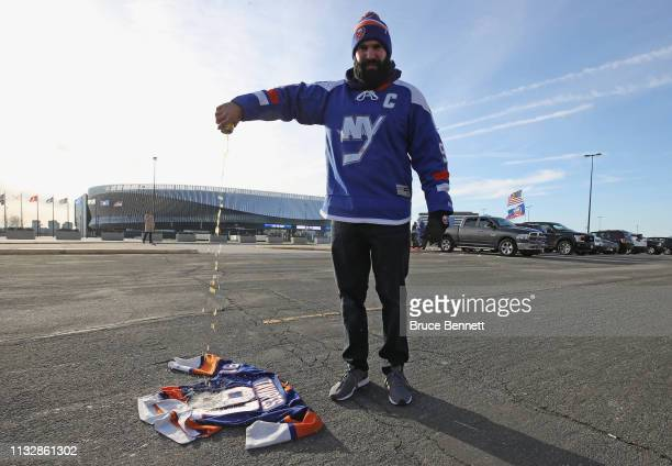 A fan pours beer on a John Tavares jersey prior to the game between the New York Islanders and the Toronto Maple Leafs at NYCB Live's Nassau Coliseum...