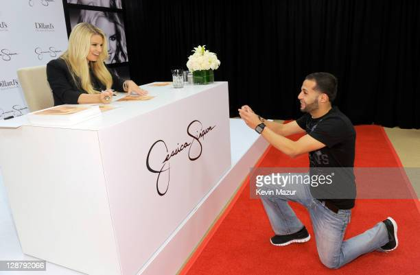 Fan proposes to Jessica Simpson at Dillard's Lakeside Shopping Plaza on October 8, 2011 in New Orleans, Louisiana.