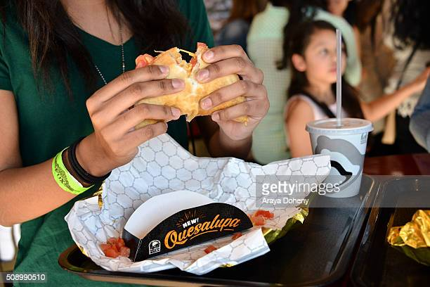 A fan pulling apart Taco Bell's Quesalupa to achieve the famous CheesePull on February 6 2016