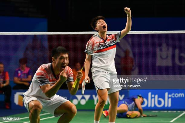 Fan Qiuyue and Liu Xuanxuan of China react against Na Sung Seung and Seong Ah Yeong of Korea during Mixed Doubles Round 16 match of the BWF World...