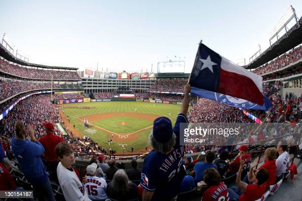 Fan raises a flag during Game Four of the MLB World Series between the St. Louis Cardinals and the Texas Rangers at Rangers Ballpark in Arlington on...