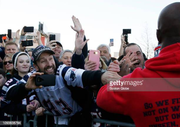 A fan reaches out to New England Patriots player Devin McCourty right as the Patriots return from Atlanta to Gillette Stadium in Foxborough MA...
