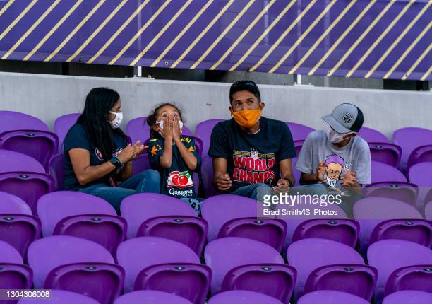Fan reacts after she was given a warm up top by Marta of Brazil before a game between Brazil and Canada at Exploria Stadium on February 24, 2021 in...