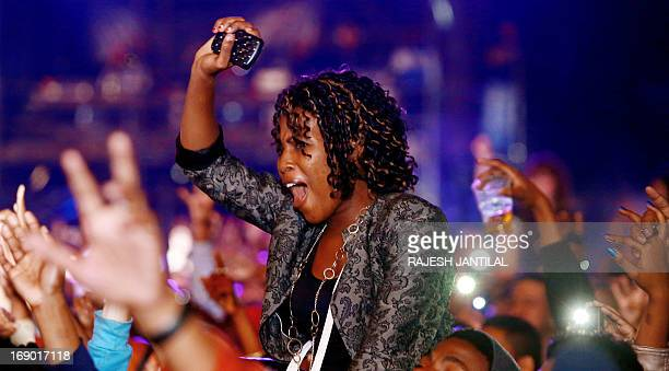 A fan reacts as Hip Hop rapper Snoop Lion aka Snoop Dogg performs on stage during the inaugural MTV All Africa Stars Concert held at the Moses...