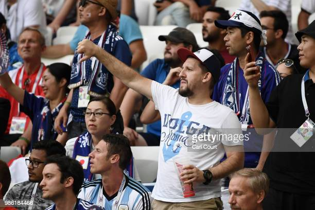 A fan reacts during the 2018 FIFA World Cup Russia group H match between Japan and Poland at Volgograd Arena on June 28 2018 in Volgograd Russia