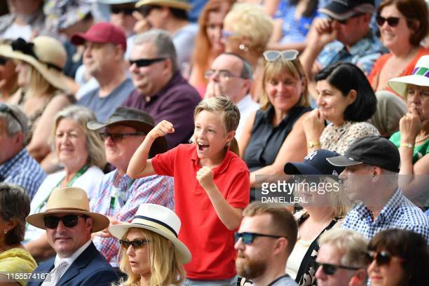 A fan reacts in the crowd as Switzerland's Roger Federer plays against Serbia's Novak Djokovic during the men's singles final on day thirteen of the...