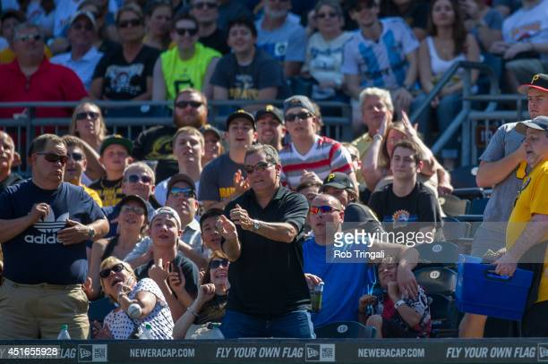 A fan reacts to a foul ball during the game between the Pittsburgh Pirates and the Milwaukee Brewers at PNC Park on June 7 2014 in Pittsburgh...