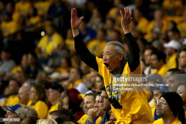 A fan reacts to a foul called against the Golden State Warriors in the first quarter during Game 2 of the NBA Finals against the Cleveland Cavaliers...