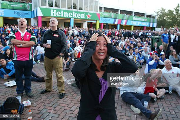 A fan reacts to the surprise victory of Japan over South Africa before the 2015 Rugby World Cup Pool D match between France and Italy at Twickenham...