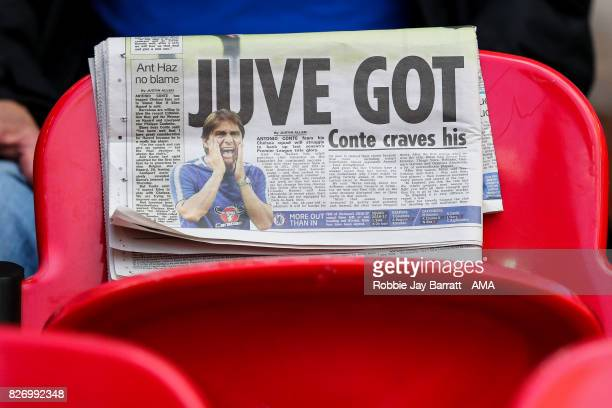 A fan reads a newspaper prior to the The FA Community Shield between Chelsea and Arsenal at Wembley Stadium on August 6 2017 in London England