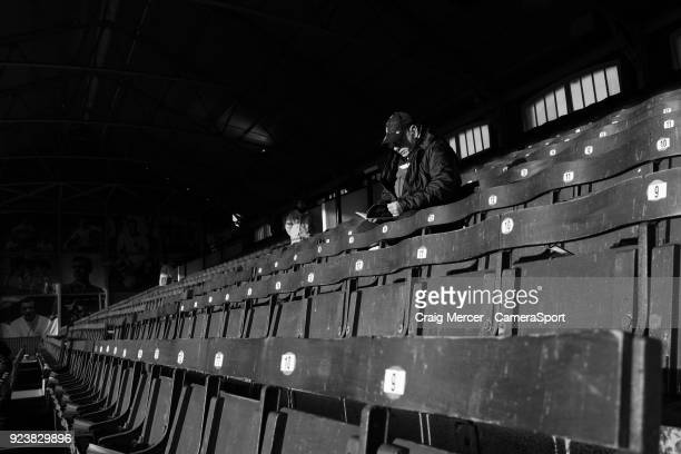 A fan reads a programme at Craven Cottage ahead of the Sky Bet Championship match between Fulham and Wolverhampton Wanderers at Craven Cottage on...