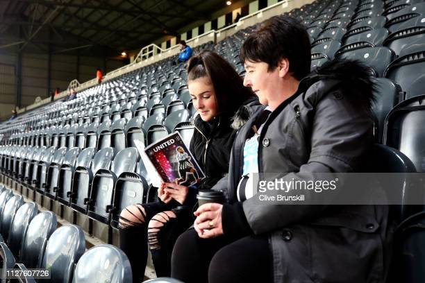 A fan reads the match day programme prior to the Premier League match between Newcastle United and Burnley FC at St James Park on February 26 2019 in...