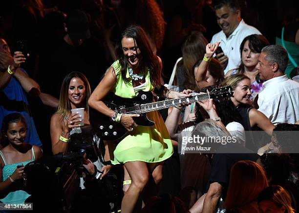 A fan receives a guitar from Keith Urban while he performs onstage at a oneofakind concert experience in New York City PlentiTogether LIVE bringing...