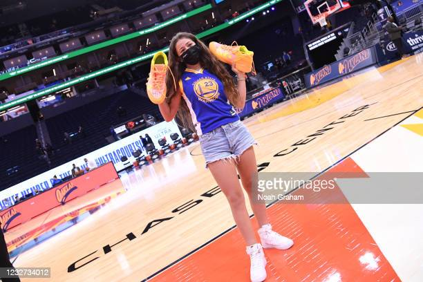 Fan receives Draymond Green of the Golden State Warriors sneakers after the game against the Oklahoma City Thunder on May 6, 2021 at Chase Center in...