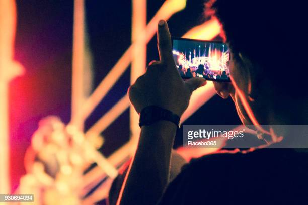 fan recording music concert on mobile telephone - k pop stock pictures, royalty-free photos & images