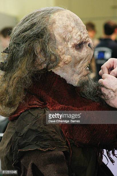 Fan Robert Davidson is transformed in to an Orc by Makeup Artist Gino Avecedo at The Fellowship Festival 2004 aimed at J R R Tolkien fans at...