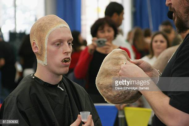 Fan Robert Davidson is turned into an Orc by Makeup Artist Gino Avecedo at The Fellowship Festival 2004 aimed at J R R Tolkien fans at Alexandra...