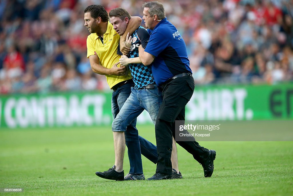 A fan runs on the pitch during the friendly match between FC Eindhoven and PSV Eindhoven at Philips Stadium on July 26, 2016 in Eindhoven, Netherlands.