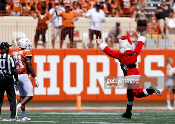 Fan runs onto the field dressed as Santa Claus in the fourth quarter of the game between the Texas Longhorns and the Texas Tech Red Raiders at...