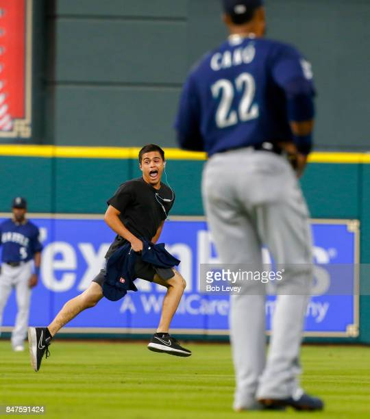 A fan runs onto the field in the first inning of a baseball game between the Seattle Mariners and Houston Astros at Minute Maid Park on September 15...
