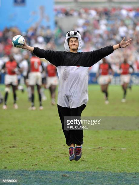 A fan runs onto the pitch on the last day of the Hong Kong Rugby Sevens the fifth leg of the IRB World Seven Series on March 29 2009 Hong Kong is the...