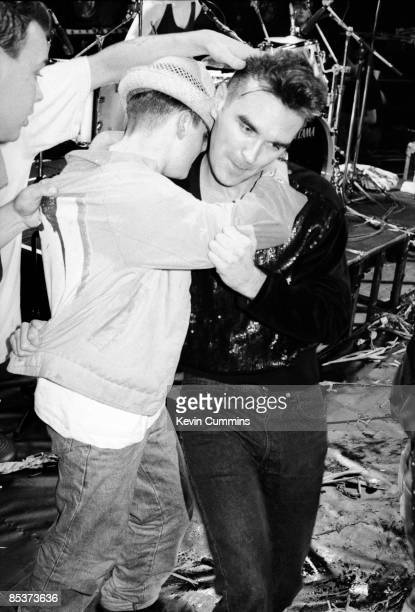 A fan rushes to embrace English singer and lyricist Morrissey at his first solo concert after the breakup of The Smiths at Wolverhampton Civic Hall...