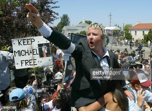 Fan Sean O'Kane from Ireland cheers after hearing that pop singer Michael Jackson was not found not guilty on all ten counts of child molestation in...